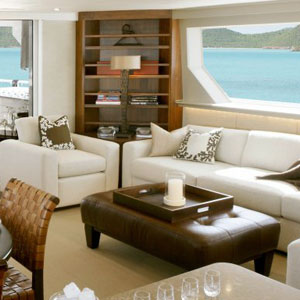 main salon of seattle yacht with upholstered couches