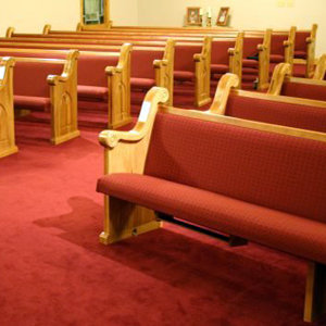seattle church pews upholstered in rust fabric